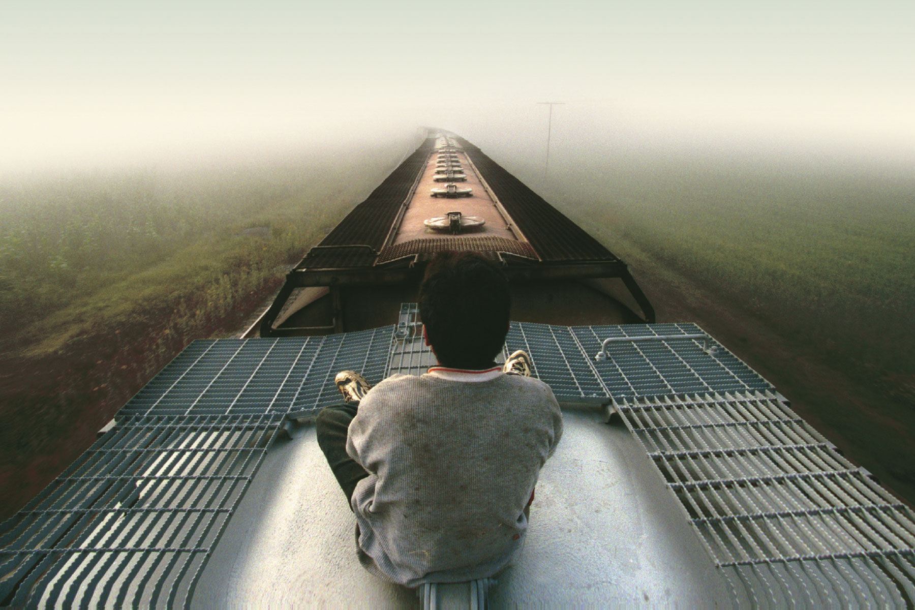 Cover of book, child on top of train